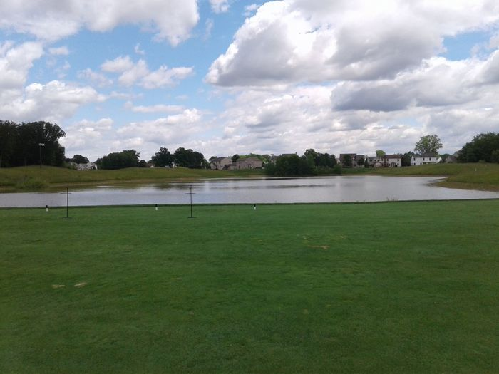 View of a pond next to the practice facility at Delaware Golf Club