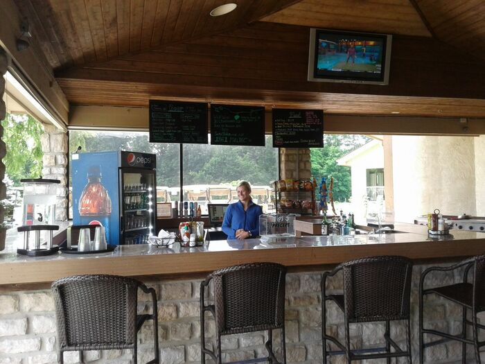 A bartender poses for a photo behind the bar at the DGC Pub
